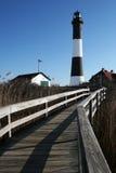 маяк острова пожара к дорожке Стоковая Фотография