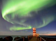 Маяк Gardur под северным сиянием, Исландией Стоковое фото RF