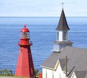 Маяк Martre Ла и церковь, Квебек Стоковые Изображения