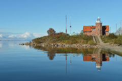 Маяк Uostadvarsky старый на острове в Литве Стоковое фото RF