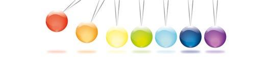 Маятник Newton в цветах радуги Стоковая Фотография