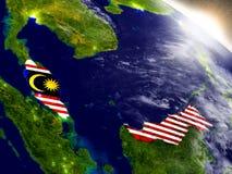 Малайзия с флагом в восходящем солнце Стоковые Изображения RF