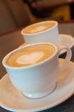 Малая белая чашка фарфора горячего капучино Стоковое Изображение