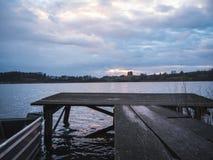 Малая деревянная пристань на заходе солнца Стоковое Изображение