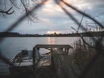 Малая деревянная пристань на заходе солнца Стоковая Фотография