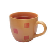 Малая оранжевая чашка чаю Стоковые Фотографии RF