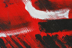 Малая часть покрашенной стены металла с черной, красной и белой краской Стоковые Фото