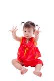 Маленькая азиатская девушка (тайская) в cheongsam традиционного китайския Стоковые Изображения