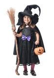 Маленькая ведьма с веником и тыквой Стоковые Фото