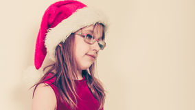 Маленькая девочка выглядеть как эльф santa Стоковая Фотография