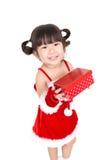 Маленькая девочка в красном костюме santa на белой предпосылке Стоковые Изображения