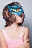 Маленькая девочка в маске масленицы Стоковые Фотографии RF
