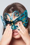Маленькая девочка в маске масленицы Стоковое Фото