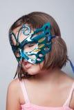 Маленькая девочка в маске масленицы Стоковая Фотография