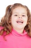 Маленькая девочка в пинке смеясь над вне громко Стоковая Фотография