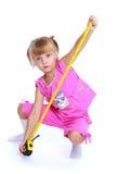 Маленькая девочка в розовом костюме Стоковые Изображения