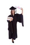 Маленькая девочка в хламиде студента с дипломом и стогом книг Стоковое Фото