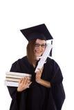 Маленькая девочка в хламиде студента с дипломом и стогом книг Стоковые Фото