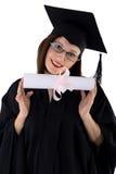 Маленькая девочка в хламиде студента с дипломом Стоковое Изображение RF