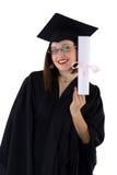 Маленькая девочка в хламиде студента с дипломом Стоковое Фото