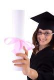 Маленькая девочка в хламиде студента с дипломом Стоковые Фото
