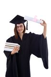 Маленькая девочка в хламиде студента с дипломом Стоковые Фотографии RF