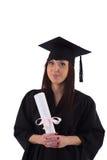 Маленькая девочка в хламиде студента с дипломом Стоковые Изображения RF