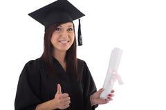 Маленькая девочка в хламиде студента с дипломом Стоковое Изображение