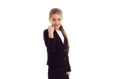 Маленькая девочка в черной куртке держа дипломата Стоковое Изображение RF