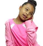 Девушка на телефоне изолированном на белизне Стоковые Фото