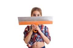 Маленькая девочка держа нож замазки Стоковое Фото