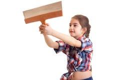 Маленькая девочка держа нож замазки Стоковая Фотография RF
