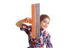 Маленькая девочка держа нож замазки Стоковое Изображение