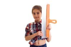 Маленькая девочка держа нож замазки Стоковые Изображения