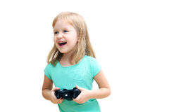 Маленькая девочка держа gamepad стоковые фотографии rf