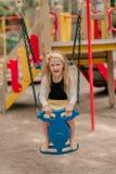 Маленькая девочка едет на качании Стоковое Изображение