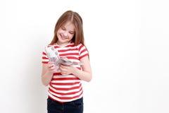 Маленькая девочка и русские деньги Стоковые Фото