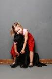 Маленькая девочка и собака в студии Стоковая Фотография RF