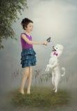 Маленькая девочка и собака стоковые фото