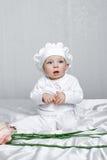 Маленькая девочка и цветки Стоковое Изображение