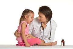 Маленькая девочка на докторе Стоковая Фотография