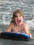 Маленькая девочка на доске буг Стоковые Фотографии RF