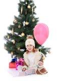 Маленькая девочка на рождественской елке Стоковое Изображение