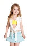 Маленькая девочка нося голубую юбку Стоковая Фотография
