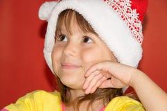 Маленькая девочка нося шляпу santa Стоковая Фотография