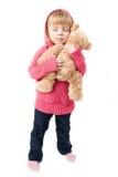 Маленькая девочка обнимая плюшевый медвежонка Стоковое Фото