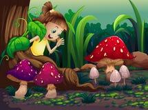 Маленькая девочка около корней гигантского дерева Стоковое Изображение RF