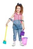 Маленькая девочка подметая пол Стоковая Фотография