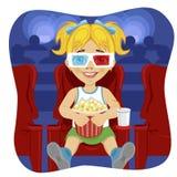 Маленькая девочка при стекла 3d держа попкорн сидя на стуле в кино иллюстрация вектора