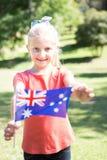 Маленькая девочка развевая австралийский флаг Стоковая Фотография